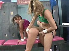 Two hot lesbians in the locker room use tongue and toys to please