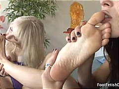 These two lesbin babes are into some foot fetish as they warm up