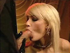 Latex-loving slut made to love two huge cocks pounding away at her holes