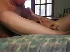 Hubby is licking and pleasing his wife with a dildo