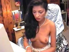 Sexy brunette amateur stuffs lit candles in her juicy twat on her webcam