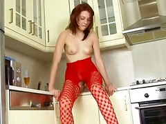 Bala in crotchless hose wets down her body
