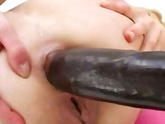 Huge black vibrator in her tight asshole