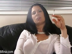Beauty in a white blouse smokes