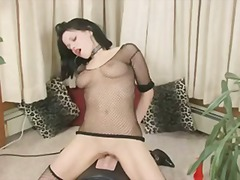 Busty chick rides a sybian