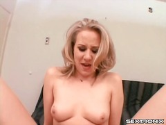 Sexy looking blonde slowly sits on his cock