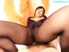 Milf in pantyhose giving footjob riding on guy
