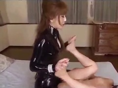 Slave girl in mask getting her pussy fucked with strapon by mistress on the bed in the room