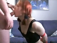 Red-haired doxy in leather breeches is submitted to rod-engulfing action