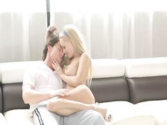 Luxury blonde copulating on white couch