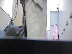 Changing room russian model in black panty and stockings