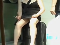 Smoking woman is flashing her upskirt on the voyeur camera aae9