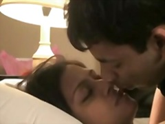 Indian couple honeymoon passionate giving a kiss and sex